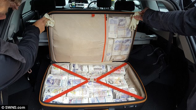 Haul: This suitcase containing £500,000 in £10 and £20 notes was found in the back of a car in a separate incident
