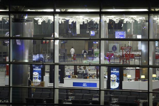 Officials walk inside Turkey's largest airport, Istanbul Ataturk