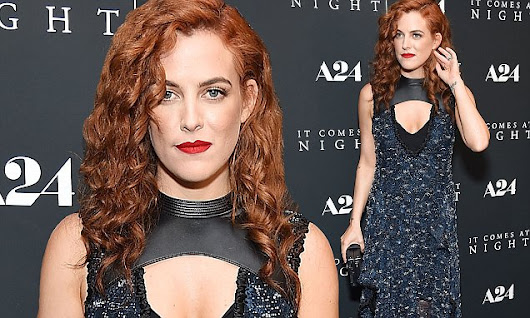 Riley Keough shows off fiery red hair and cleavage