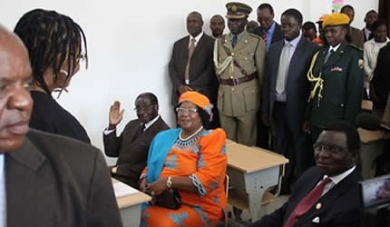 President Mugabe and visiting Malawian President Joyce Banda and her husband Retired Chief Justice Richard Banda simulate a class situation with First Lady Amai Grace Mugabe being the teacher at Amai Grace Mugabe School in Mazowe April 26, 2013. by Pan-African News Wire File Photos