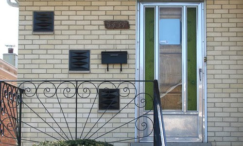 Storm door, with railing and colored glass block