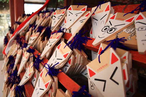 Fox faces with wishes in the Fushimi Inari Shrine