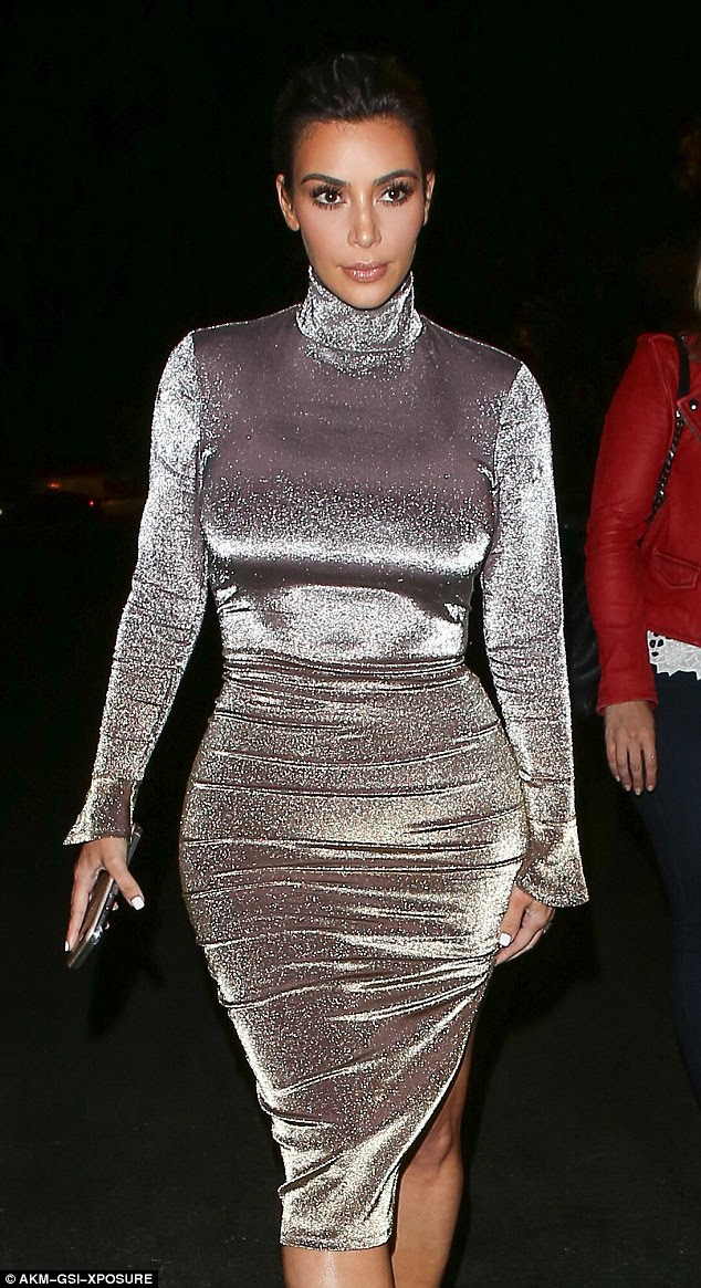 Pretty: Kim had natural, complimentary make-up on her face topped off with a swipe of shiny pink lip
