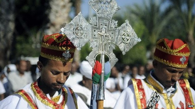 Eritrean Christians lead a memorial service held in Tel Aviv, on 12 October 12, 2013, in honour of victims of the Lampedusa shipwreck , off Italy's southern-most point