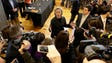 Clinton speaks to members of the media after meeting