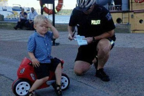 3-year-old Declan Tramley gets 'pulled over by a cop' and given a ticket for parking his toy motorbike in a no parking zone