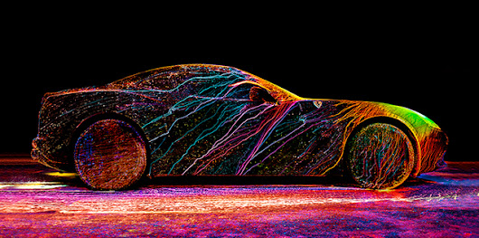Photographer Coats a Ferrari in an Explosion of Color with UV Paint and a Wind Tunnel