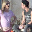 Could they sit any further apart? Jennifer Aniston appears to be giving Justin Theroux a piece of her mind as she stands hand-on-hip