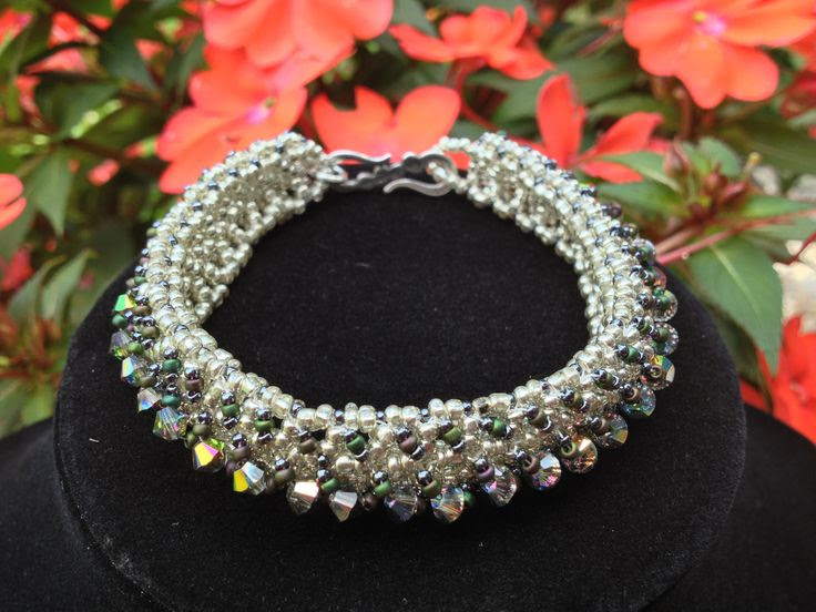 "One of my first recent projects: RAW Beauty bangle. RAW refers to the ""right angle weave"" represented by the silver seed beads. Swarovski and colored seed beads included. Original design by Donna Pagano Denny."