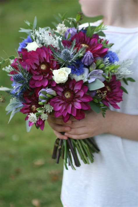 Wedding bouquet in burgundy, blue, lilac and white