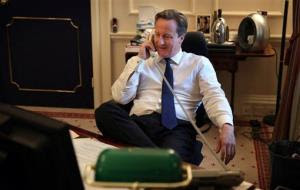 Britain's Prime Minister David Cameron talks to US President Barack Obama on the telephone from his office in Downing Street, London, Thursday Nov. 8, 2012.