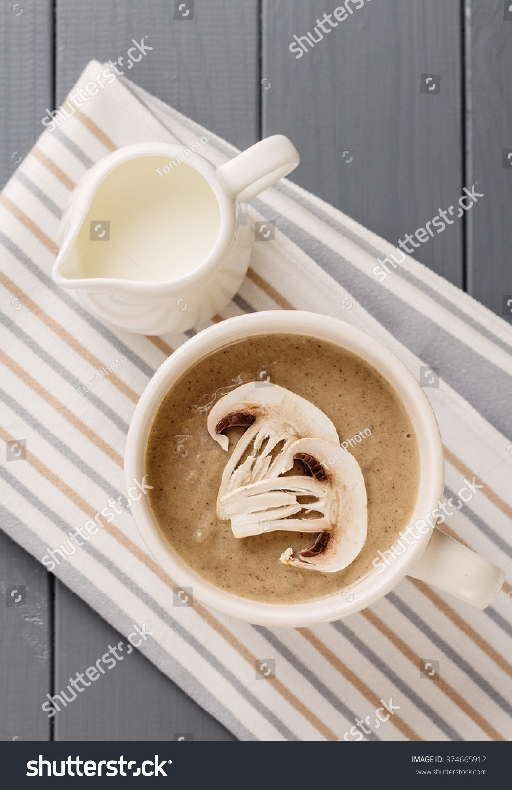 http://www.shutterstock.com/pic-374665912/stock-photo-creamy-mushroom-soup-in-a-big-cup-decorated-with-sliced-champignons-on-gray-background-top-view.html