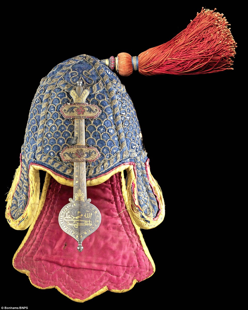 This rare quilted helmet with a gold koftgari bar, incredibly artistic stitching and the wonderfully bright colours of India is set to sell for £35,000