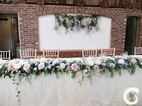 Top table garland and hanging flower backdrop   Rustic