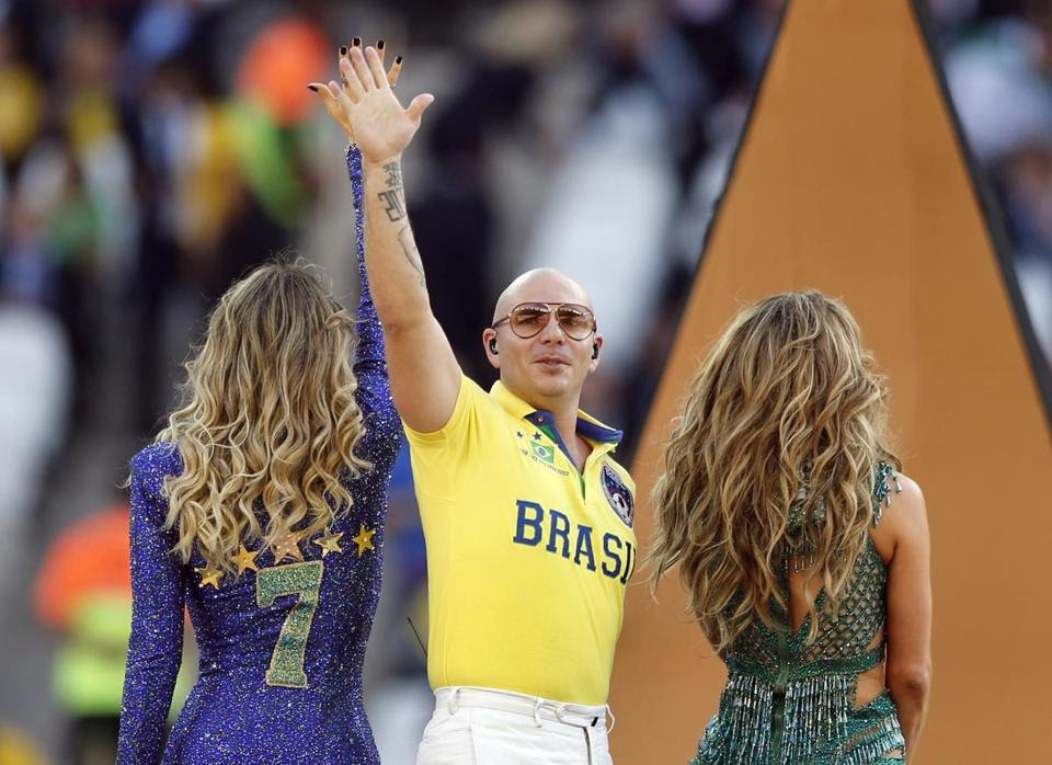 Pitbull with fellow US singer Jennifer Lopez (right) and Brazilian singer Claudia Lette, (left) during the opening ceremony.