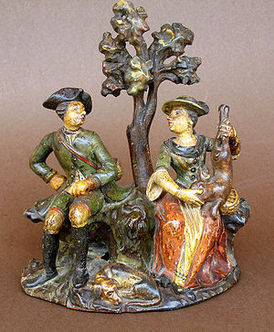 Carved gallant genre scene with figurines from...