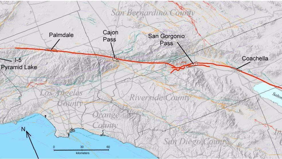 The San Andreas fault, in heavy red, slices through key mountain passes including the San Gorgonio Pass and the Cajon Pass.