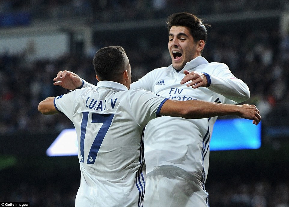 Subsititute Vazquez celebrates after scoring his side's fourth goal with fellow Real Madrid substitute Morata