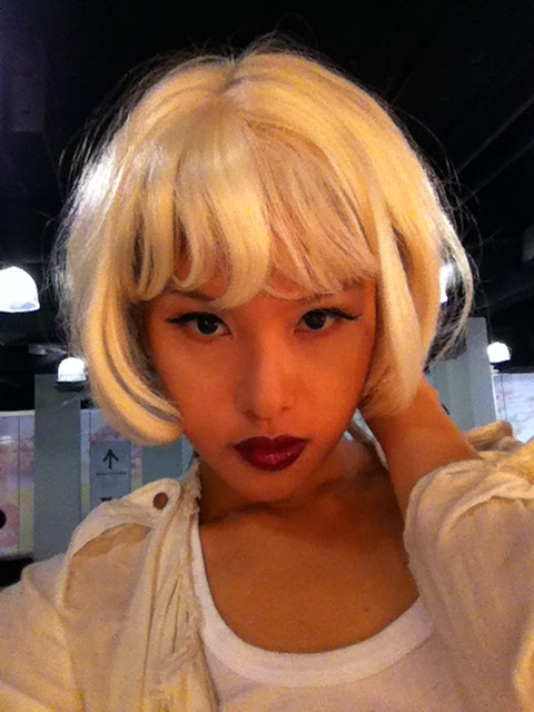 trying on platinum blonde wig