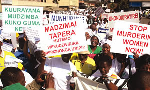 Zimbabwe women march against domestic violence. The women are demanding respect and a stable home environment for all women inside the country. by Pan-African News Wire File Photos