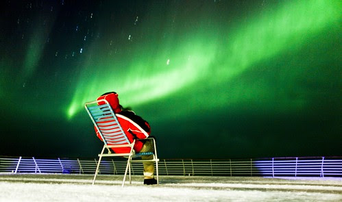 Watching the Northern Lights from deck of a Hurtigruten ship