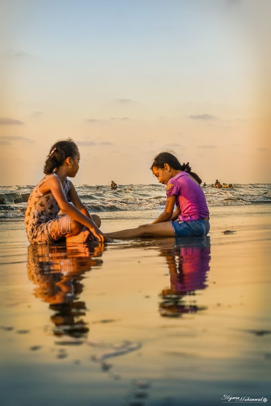 Little girls playing at sea in a summer day  by AymanMuhammad on YouPic