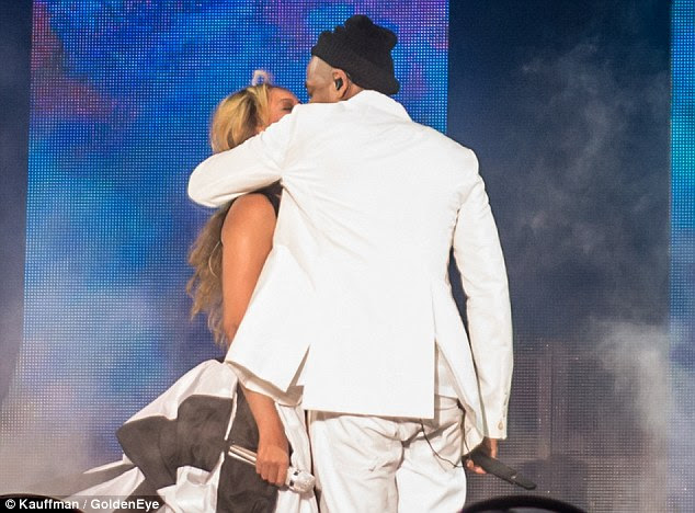 Intimate: The couple kiss during their show, prompting a cheer from the audience