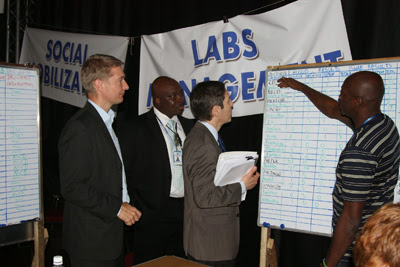 Dr. Frieden visits Sierra Leone's Western Area Command Centre, where he reviews the Ebola results data from laboratories across Sierra Leone. Left to right: Dr. Oliver Morgan, Dr. Desmond Williams, Dr. Tom Frieden.