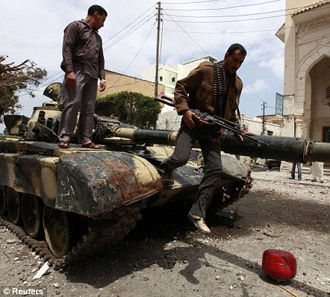 They overpowered Gaddafi troops, even managing to take control of some tanks