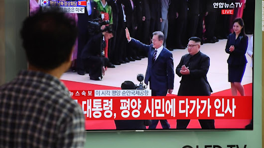 Kim Jong Un hugs Moon Jae-in as inter-Korean summit starts - CNN