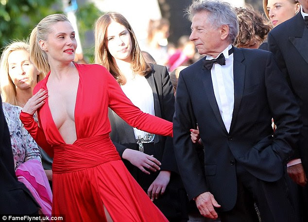 The look of love: Emmanuelle and Roman gazed at each other as they took to the red carpet