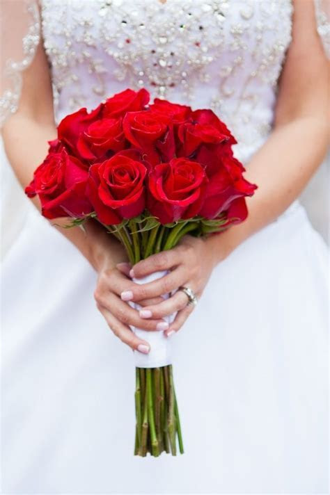 Bright red rose bouquet tied with white ribbon