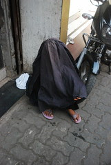 The Muslim Beggar Has To Hide Her Face To Hide Her Eternal Shame by firoze shakir photographerno1
