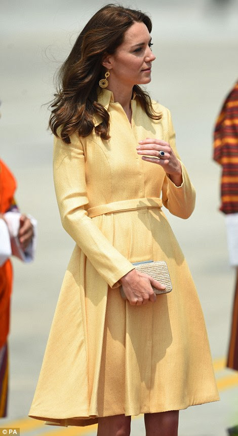Fashion favourite: Kate opted for a pale gold coat dress by designerEmelia Wickstead for her flight from India today
