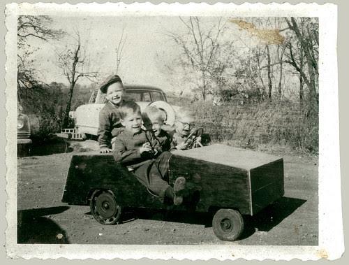 Four children in a push car