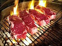 Beef steaks being grilled