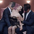 No one will be listening to your voice! Dita Von Teese makes her singing debut as she cavorts on a bed in her lingerie with two masked men for raunchy video