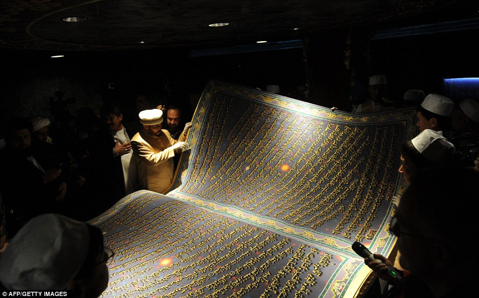 Important day: Key religious figures, clerics, scholars and government officials admire the text's 218 pages during the ceremony at the Hakim Nasir Khusraw Balkhi Cultural Center