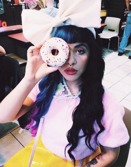 Back in my day, we used to eat donuts instead of hiding one eye with them and taking a pic to post of social media.