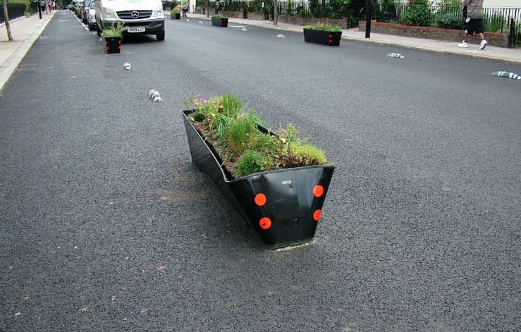 Some of the planters on Royal College Street have been damaged by motorists - image from Alternative Department for Transport