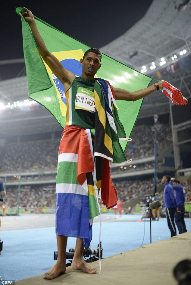 Unstoppable: South African sprinter Wayde van Niekerk wrote his name into the record books tonight as he smashed the 400m world record