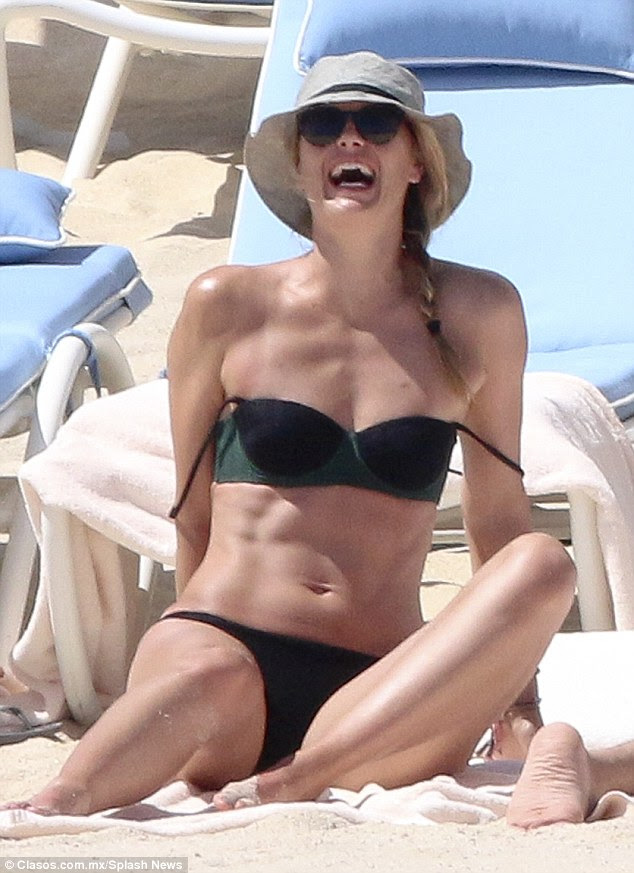 Revealing: She also showed off her washboard abs as she had a big laugh