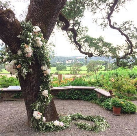 Wedding Wednesday :: Flower Garlands on Trees   Flirty