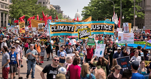 Climate March Draws Thousands of Protesters Alarmed by Trump's Environmental Agenda - The New York Times