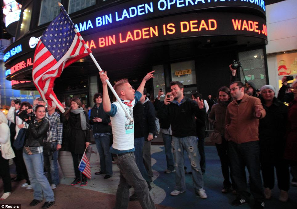Americans celebrate the death of Osama bin Laden in Times Square in New York, after the Al Qaeda leader was killed in Pakistan