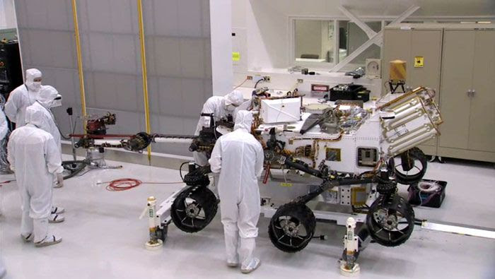 Engineers install a robotic arm onto the CURIOSITY Mars Rover at NASA's Jet Propulsion Laboratory in Pasadena, California.