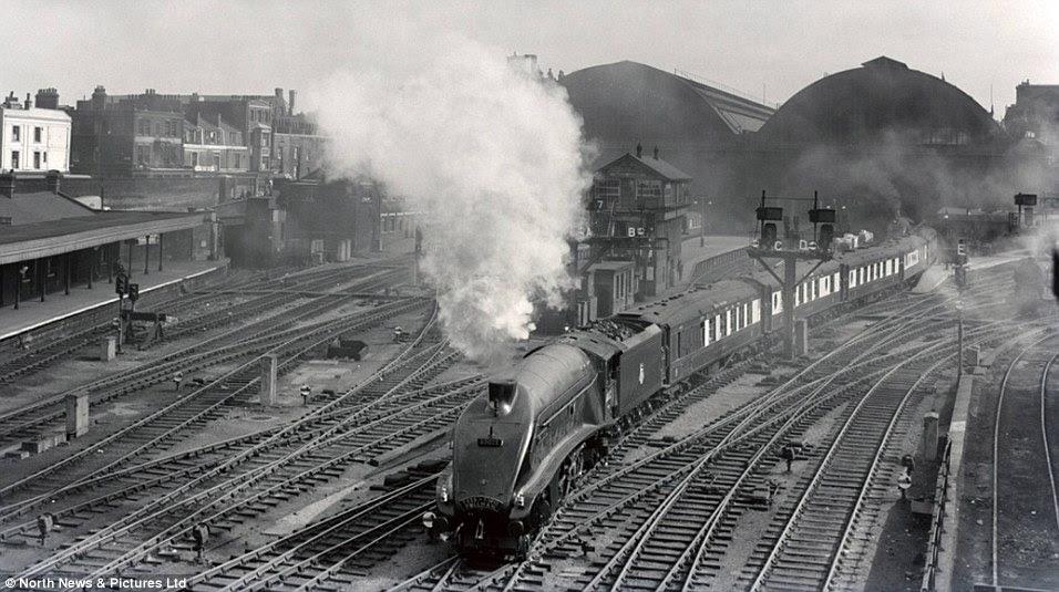 The Mallard is seen leaving London King's Cross Station heading to Newcastle in 1955