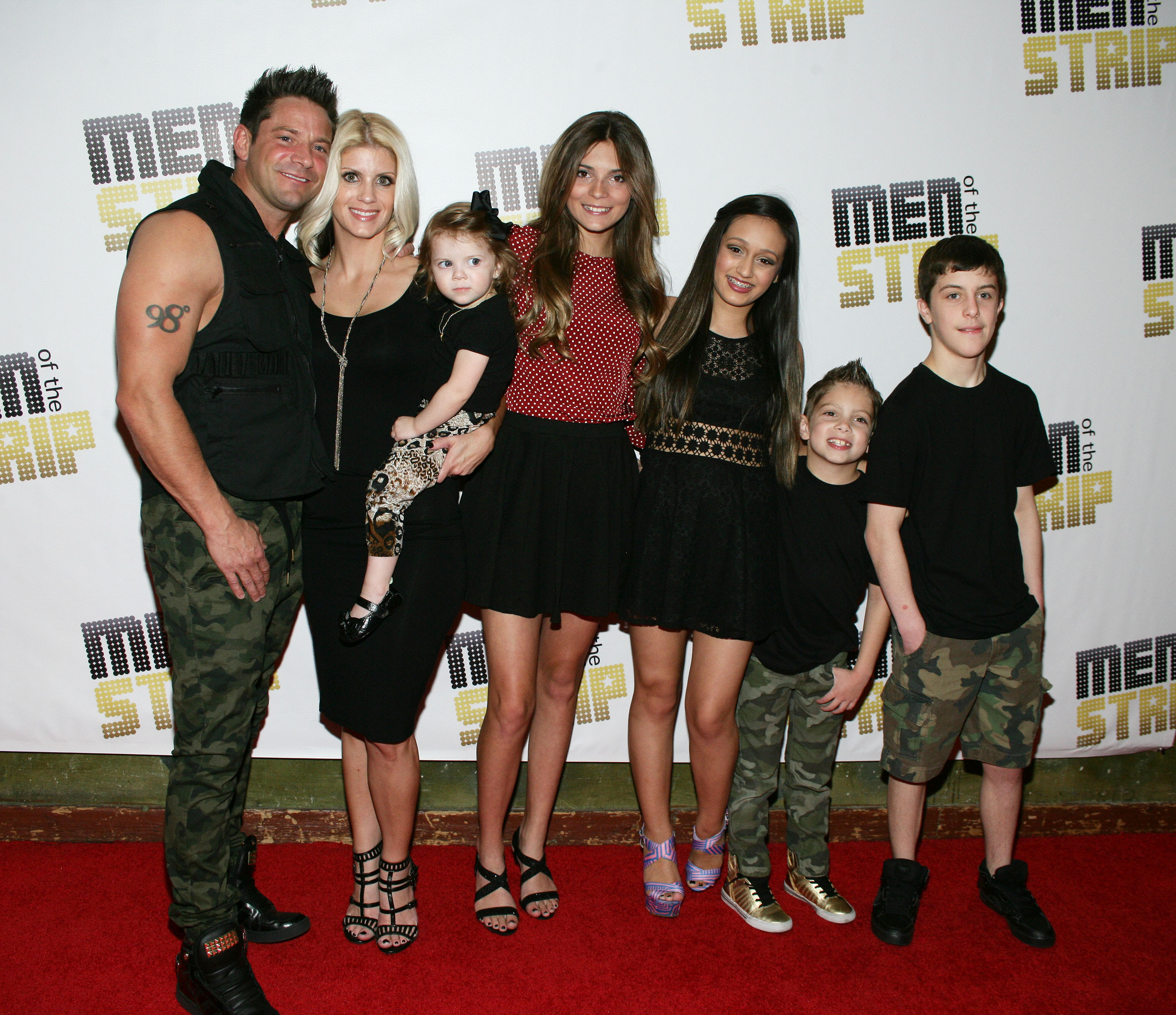 "Jeff Timmons with wife Amanda and their family at  ""Men of the Strip"" at House of Blues at Mandalay Bay in Las Vegas on March 29."
