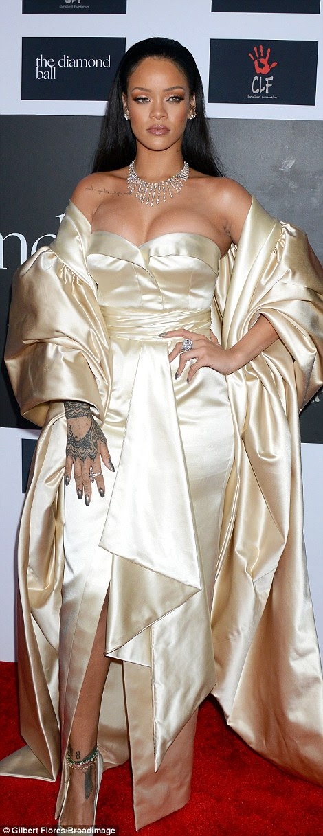 Hot metal: Rihanna dazzled in a gold gown at her Diamond Ball in Los Angeles on Thursday