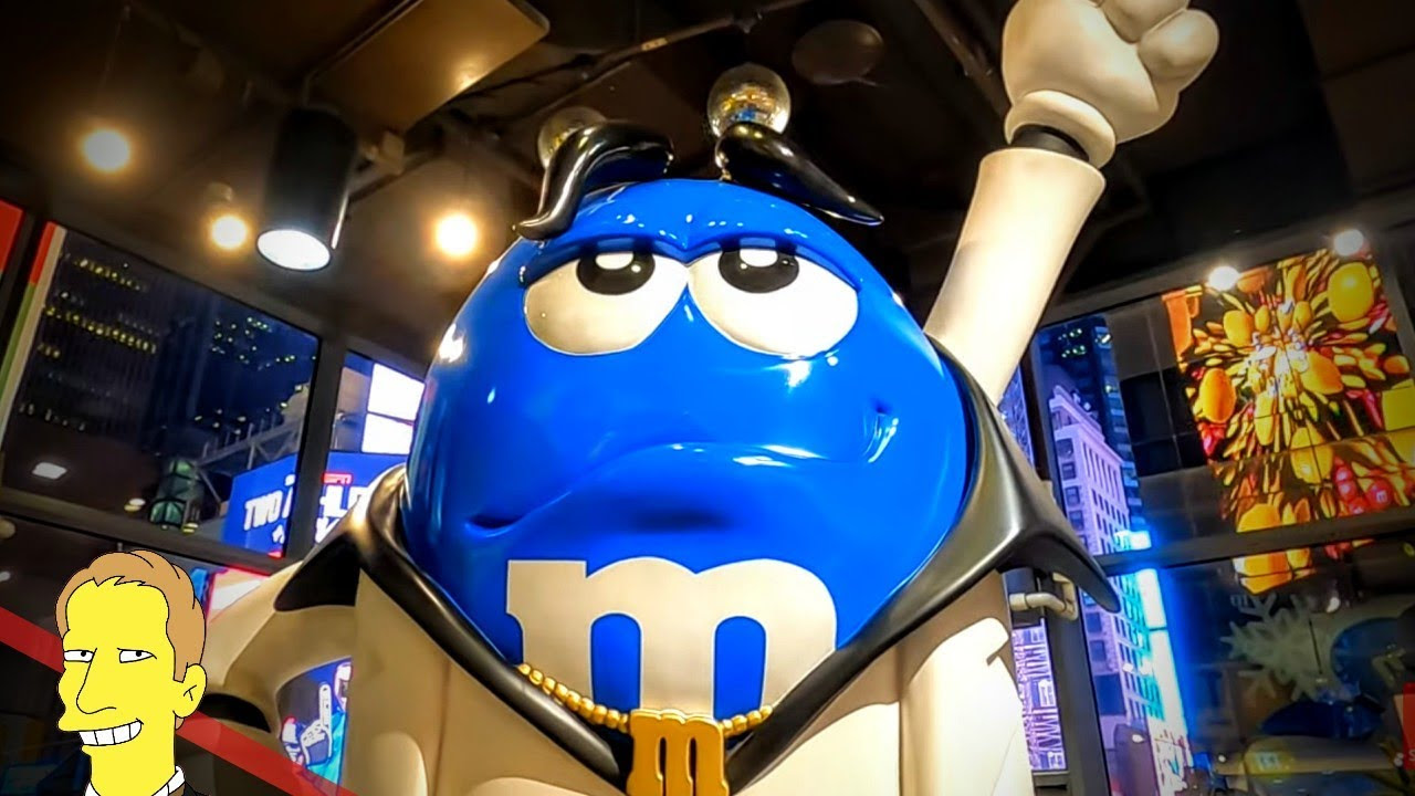 plastic statue of blue m&m mascot dressed in disco outfit at M&Ms World New York